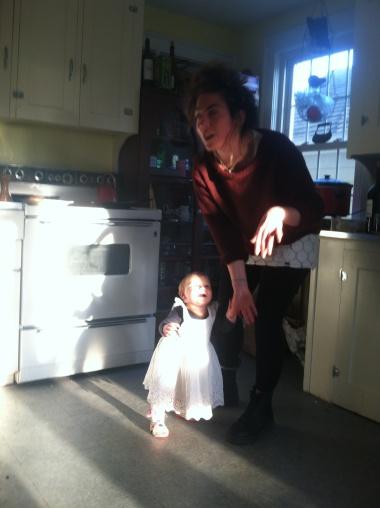 Cassandra and Naomi dance in grandma's kitchen